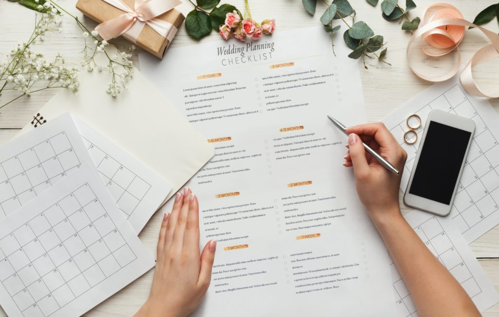 A wedding planner going over a schedule